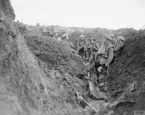 A group of British soldiers standing in a muddy trench