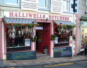 The above photograph is of Halliwells Butchers, Selkirk, Scotland, with a string of rabbits hanging outside, a rare sight these days! © William Stafford – Creative Commons Attribution-Share Alike 2.0 Generic License.