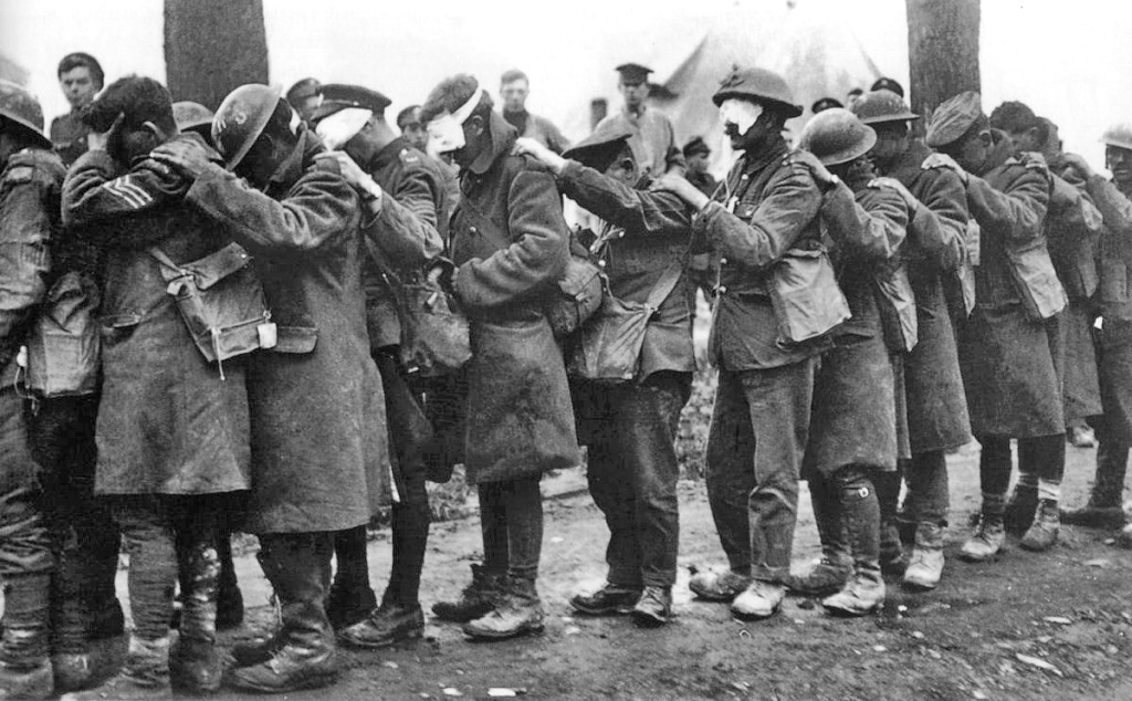 Blinded by tear gas in World War One, 55th (West Lancashire) Division troops await treatment at an advanced dressing station.