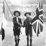 Early 1900s French and British boy scouts with their respective national flags. Source Bibliothèque nationale de France. Wikimedia Commons PD-1923.