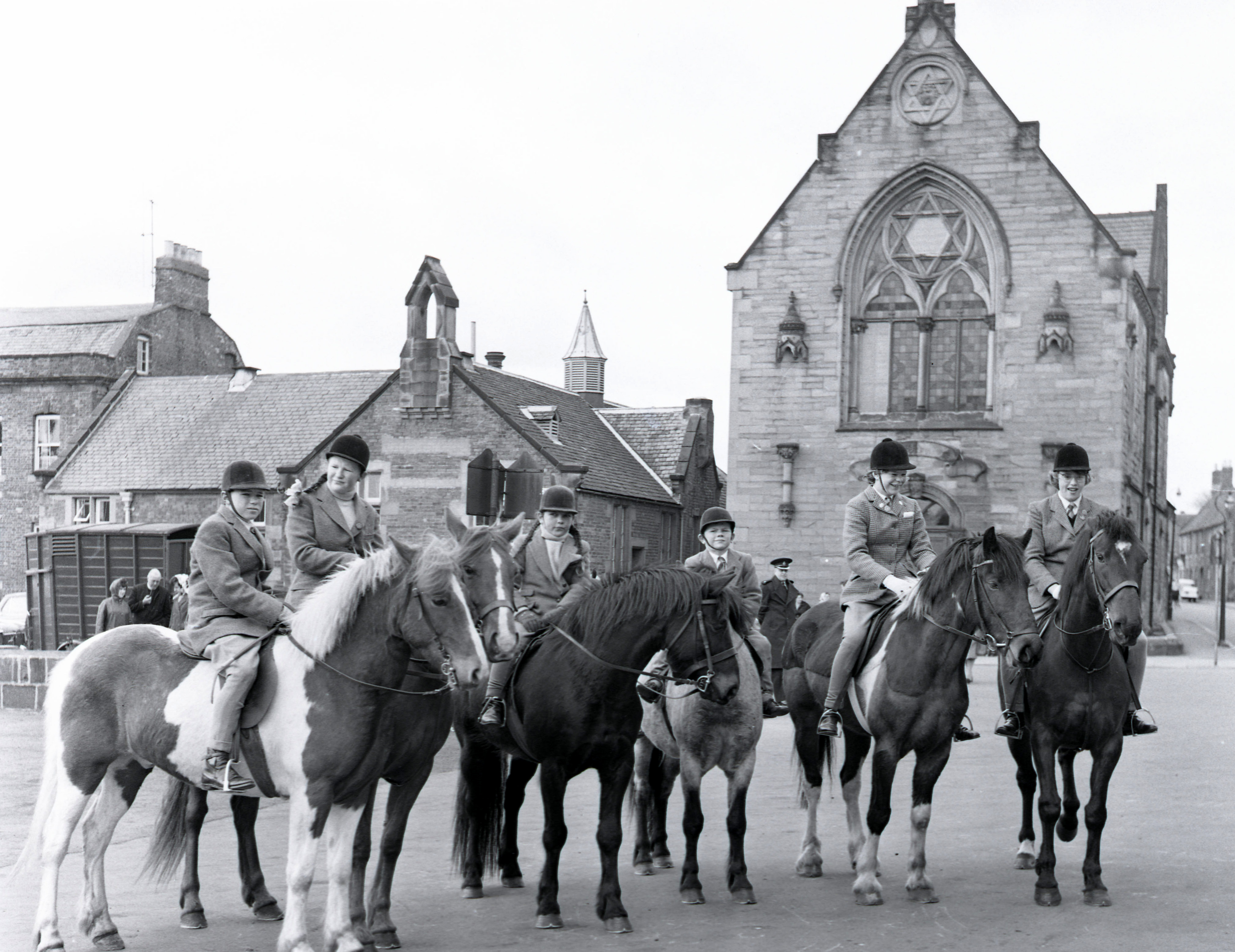 The Parade School can be seen back left in this 1950s photograph of the Riding of the Bounds in Berwick. Pictured also in the background on the right is the Freemasons' Hall. © Berwick Record Office, BRO 1944-1-4008-054.