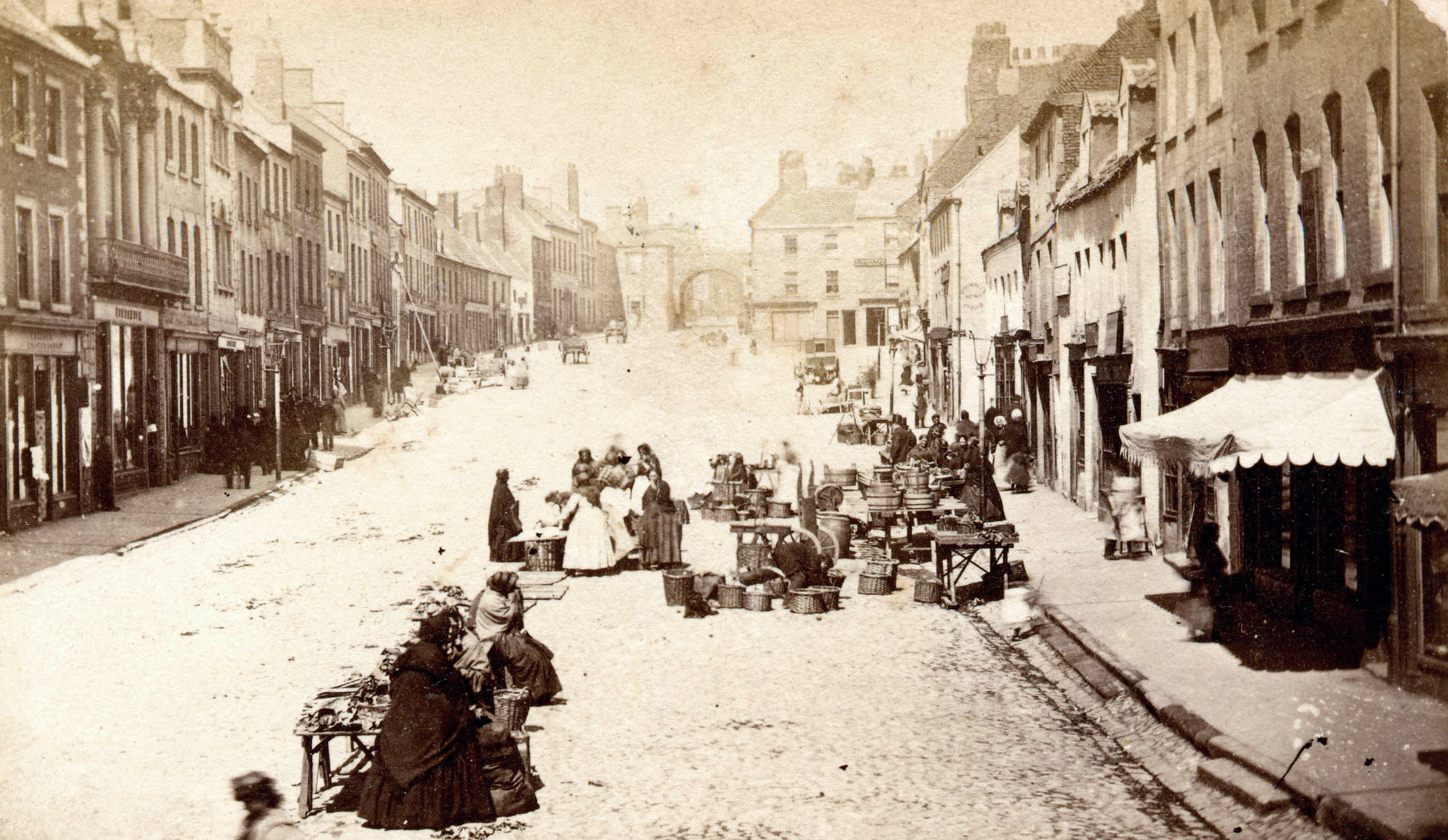 Early 1900s photograph shows people selling their wares on the High Street. © Berwick Record Office - BRO 0017