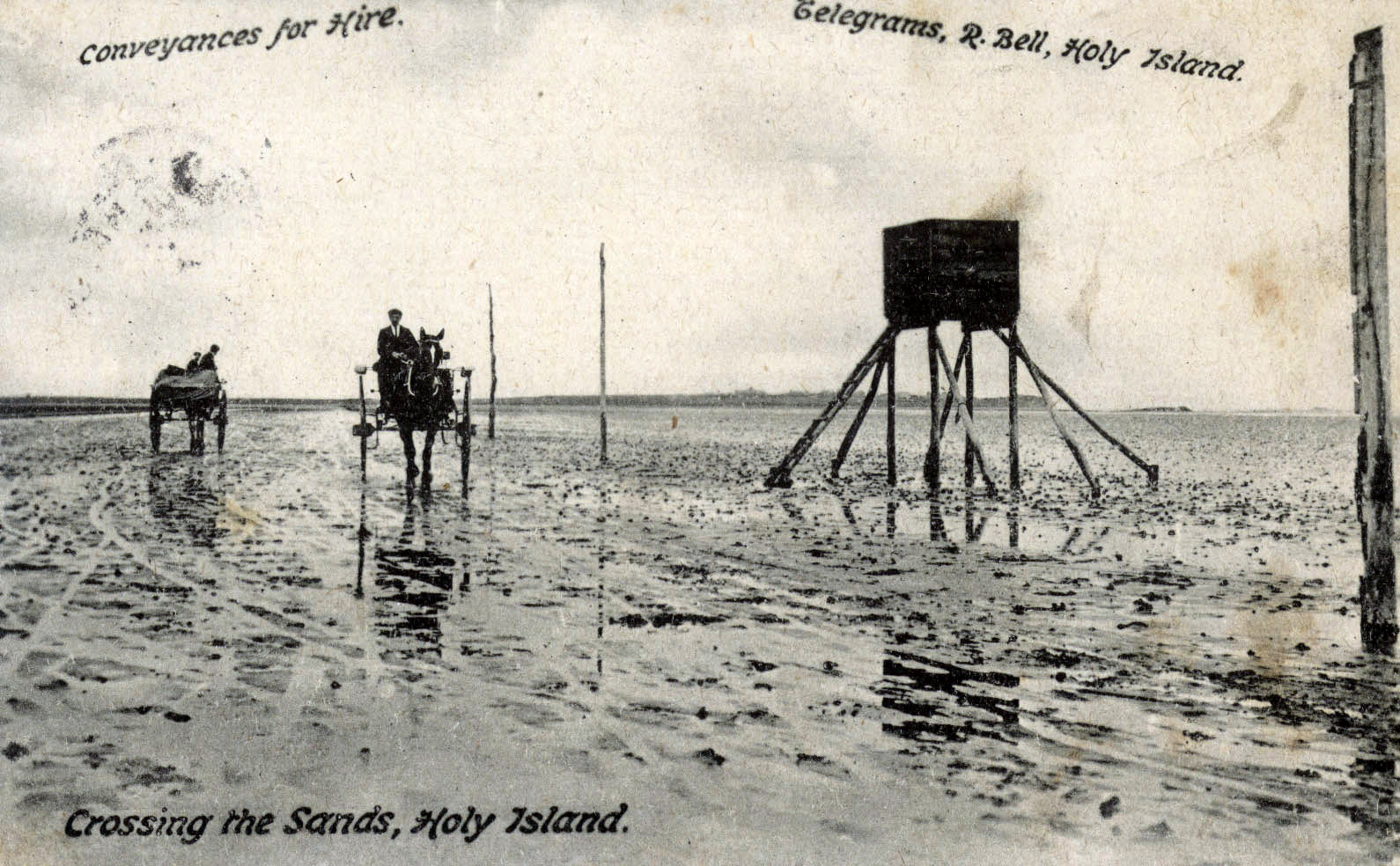 Early 20th century photograph showing the crossing of the sands at Holy Island. © Berwick Record Office, BRO 426 1059.