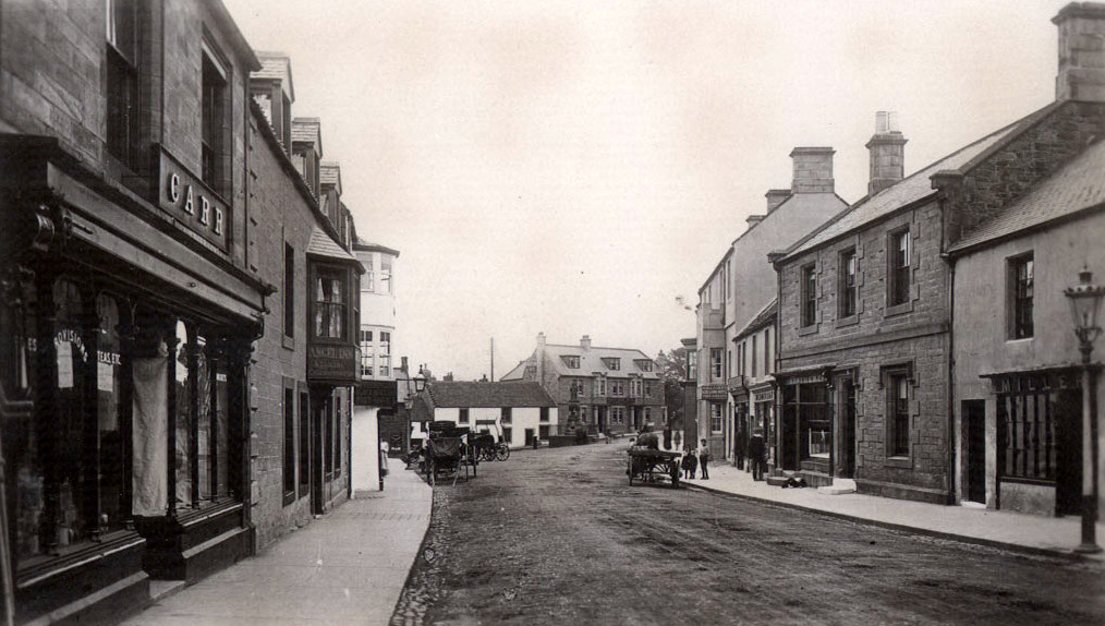 The Black Bull is the nearest white painted building on the left of the photograph. An old gas lamp can be seen on the right. © BRO 426-1228